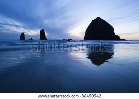 Haystack Rock at sunset, Cannon Beach, Oregon - stock photo