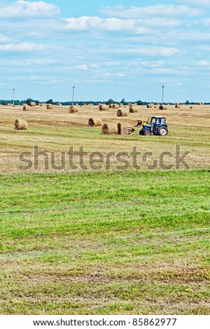Haystack tractor in the fields