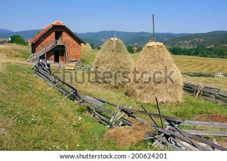 haystacks and barn in Zlatibor mountain, Serbia - stock photo