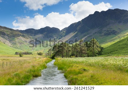 Haystacks mountain Buttermere Lake District Cumbria uk from Peggys Bridge in summer with blue sky - stock photo