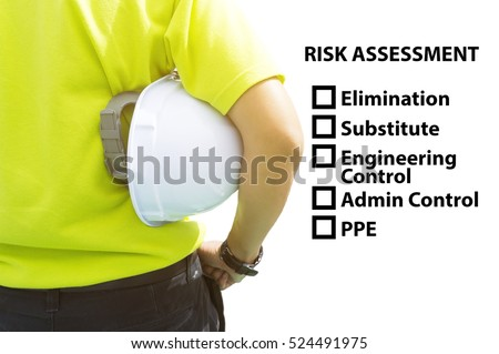 Hazard Identification and Risk Assessment concept (Safety work place) - Engineering man or Safety Inspector standing with risk assessment checklist.