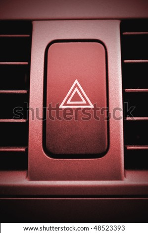 Hazard warning push button. Red concept. This button can be found in any car. - stock photo