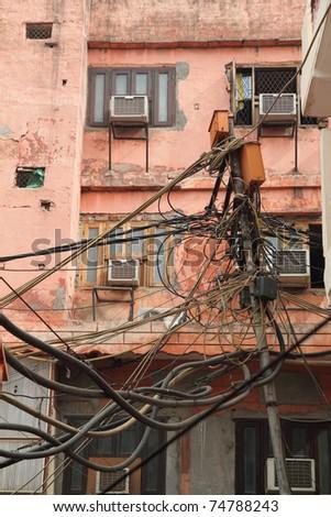 Hazardous hydro wiring in urban environment - stock photo