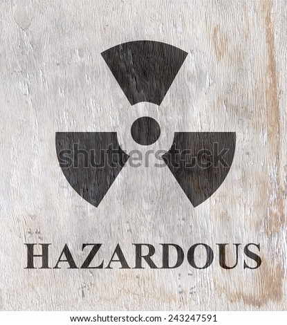 hazardous radiation sign on wood grain texture - stock photo