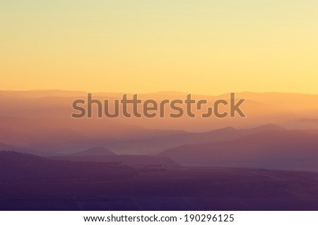 Haze in the mountains during dawn.Vintage picture - stock photo