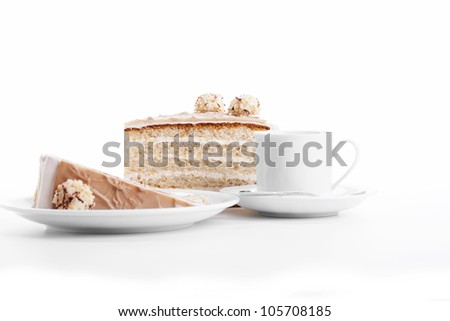 hazelnut cream cake with a cup of coffee on white background - stock photo