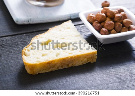 hazelnut cream sandwich breakfast and ingredients on white cutting board, black wooden table background