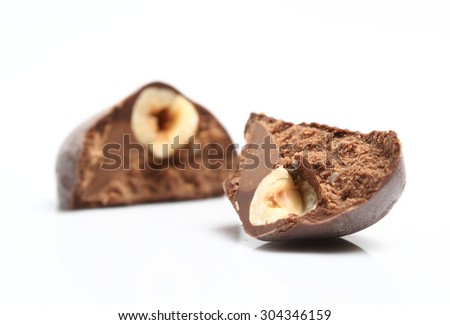 Hazelnut Praline - Truffle centre topped with a whole hazelnut dipped in milk chocolate - stock photo