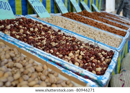 Hazelnuts and other nuts at tunisian market - stock photo