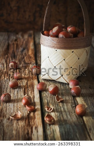 hazelnuts in a basket on an old wooden background. forest wealth. rustic style. health and diet food - stock photo