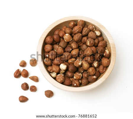 hazelnuts in a bowl on white background - stock photo