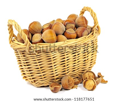 hazelnuts in basket on a white background