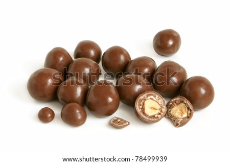 Hazelnuts in chocolate on a white background - stock photo