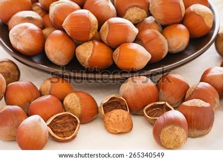 Hazelnuts, nut shells, hazelnut kernel. Selective focus - stock photo