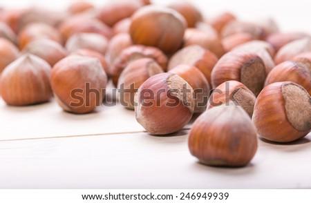 Hazelnuts on old wooden background - stock photo