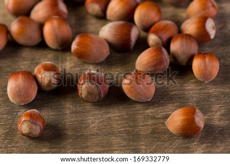 Hazelnuts on old wooden table
