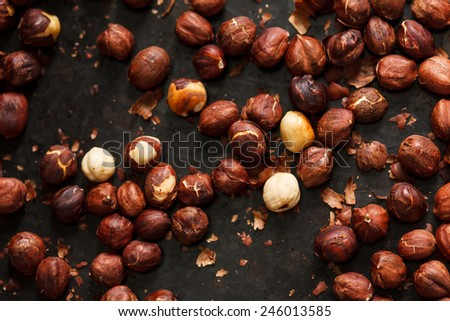 hazelnuts on the black board - stock photo