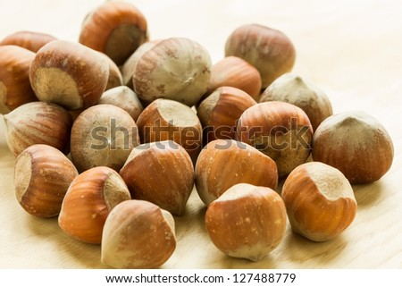Hazelnuts  on wooden background. Selective focus. - stock photo