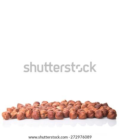Hazelnuts over white background - stock photo