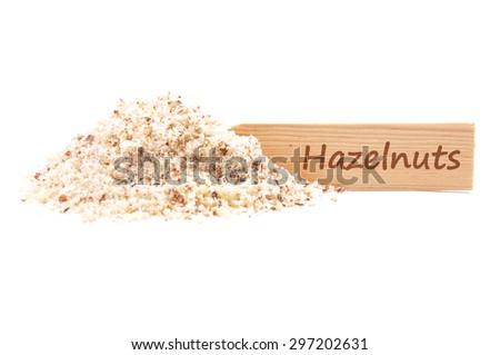 Hazelnuts powdered and plate - stock photo