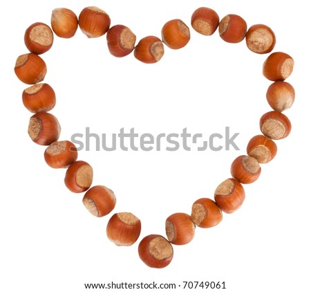 hazelnuts shaped s a heart - stock photo