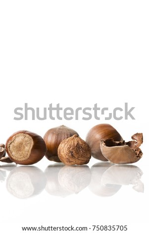 hazelnuts with broken nuts shell isolated on white