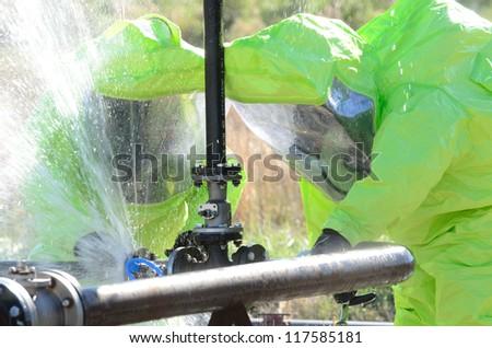 Hazmat team stopping a leak - stock photo