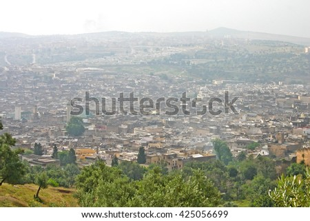 Hazy day obscures buildings in the city of Fez, Morocco - stock photo