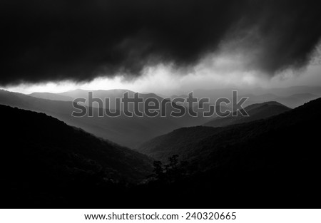 Hazy evening view of the Blue Ridge Mountains from the Blue Ridge Parkway, near Craggy Gardens in North Carolina. - stock photo