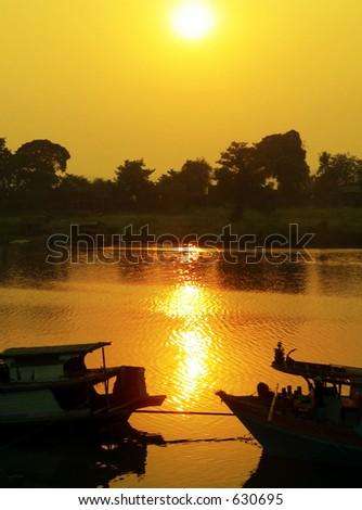 Hazy Irrawaddy River Sunset Myanmar (Burma) - stock photo