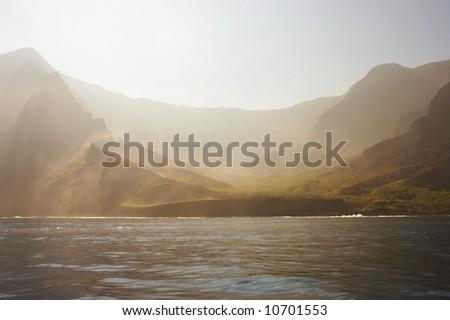 Hazy landscape of the kalalau valley on the Napali coast - stock photo