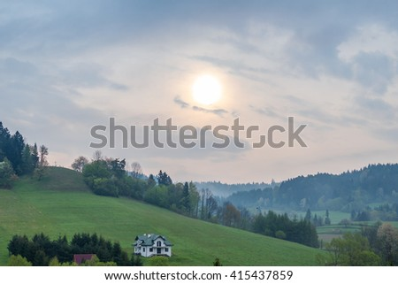 Hazy morning  above Solina lake shore (Bieszczady mountains, Poland), in the beginning of May - stock photo