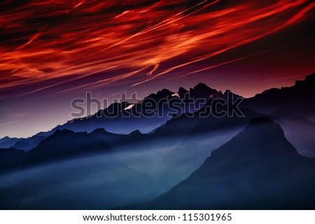 hazy morning in the Alps - stock photo