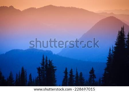 Hazy scenic view of mountain ranges in Mt. Rainier National Park, Washington, USA. - stock photo