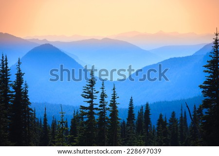 Hazy scenic view of mountain ranges in Mt. Rainier National Park, Washington, USA. - stock photo