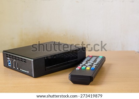 hd player with remote controler isolated on white - stock photo