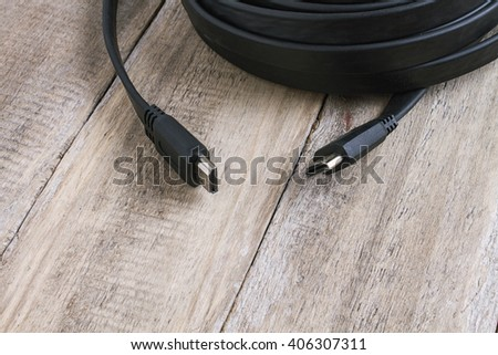 hdmi cable on wooden table - stock photo