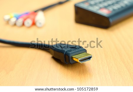 Hdmi gold connector black cable close up for hd television 1080p or blu ray 3d player on wooden background