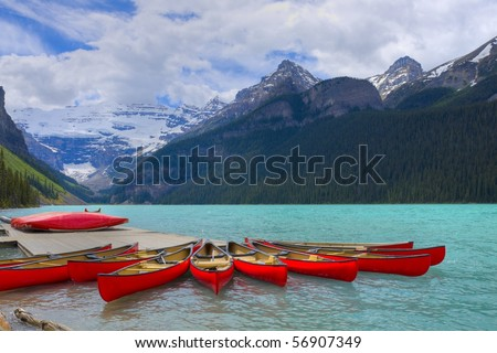 HDR Canoes on Lake Louise, Banff Canada - stock photo