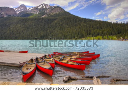 HDR Canoes on Lake Louise, Banff National Park, Alberta, Canada - stock photo
