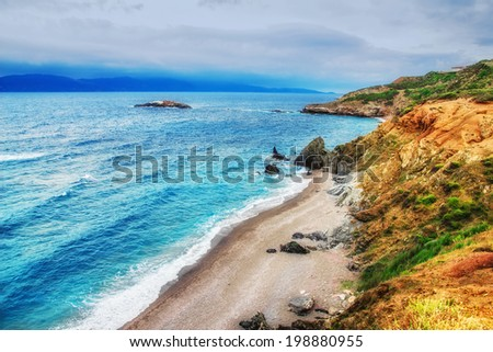 HDR image of a secluded beach on Skiathos island on a cloudy day - stock photo