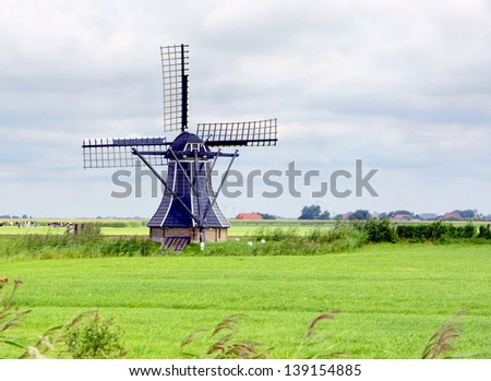 hdr image of a traditional windmill in Holland - stock photo