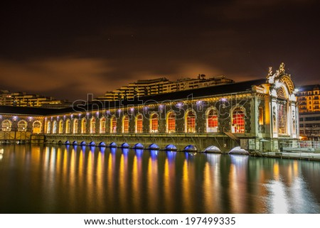 HDR image of Batiment des Forces Motrices, Geneva cultural centre architectural details in the middle of Rhone river.