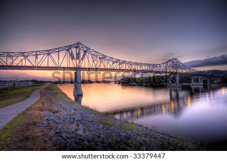 HDR image of bridge over the Mississippi River at dusk - stock photo