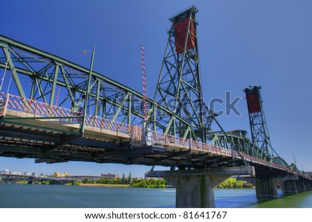 HDR image of Old Green and red Portland draw bridge against a deep blue sky - stock photo