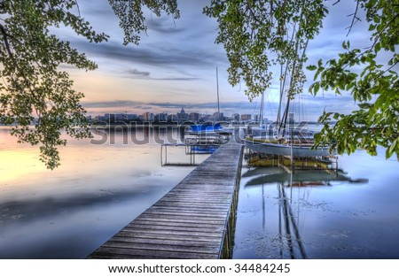 HDR image of pier and sailboats at dusk - stock photo