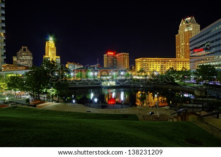 HDR image of Riverplace Park and part of Riverwalk in the center of Providence, the capital of Rhode Island, with reflections of buildings on the water at night - stock photo