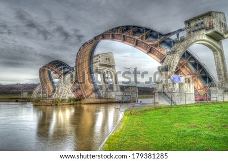 HDR image of the Driel Weir in the Netherlands. It makes part of the weir complex Amerongen, consisting of locks, a weir and a fishway in the Rhine river (Nederrijn). - stock photo