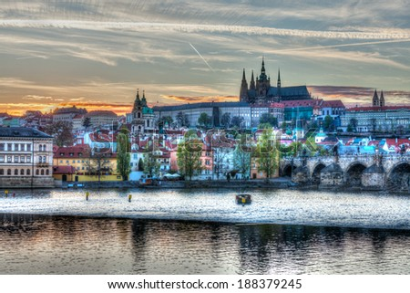 HDR image of view of Charles bridge over Vltava river and Gradchany (Prague Castle) and St. Vitus Cathedral - stock photo
