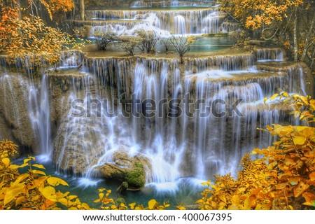 HDR landscape photo, Huay Mae Kamin Waterfall, beautiful waterfall in autumn forest, Kanchanaburi province, Thailand - stock photo